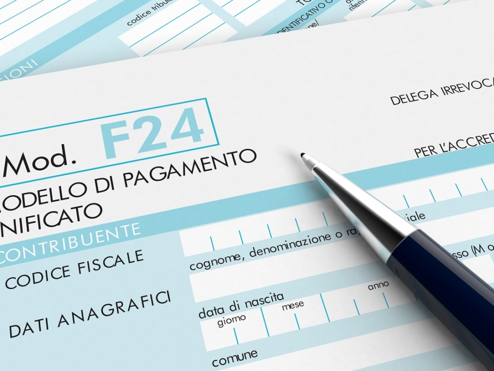 close up view of F24 form for italian taxes, with a pen (3d render)
